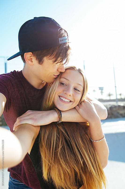 Teenage couple in love making a selfie in summer.  by BONNINSTUDIO for Stocksy United