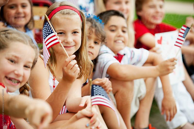 Parade: Young Americans Watch Patriotic Parade by Sean Locke for Stocksy United