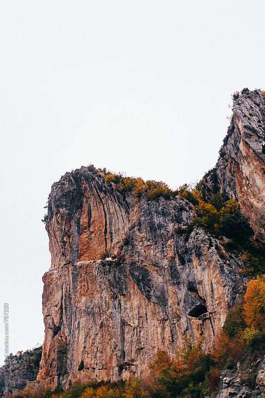 View of a cliff from above, Outumn season colors by Leandro Crespi for Stocksy United