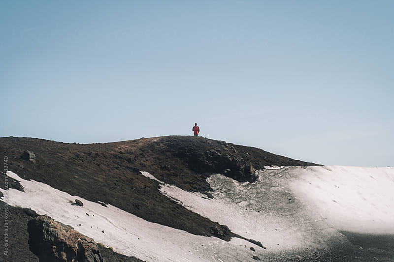 One person standing alone on the volcano cliff by Aleksandra Jankovic for Stocksy United
