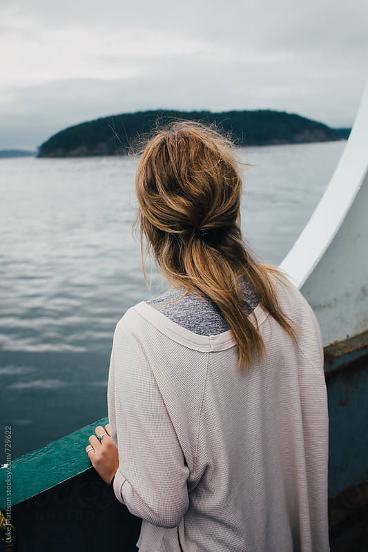 Young Blonde Woman On Ferry Looking Out Over Water by Luke Mattson for Stocksy United
