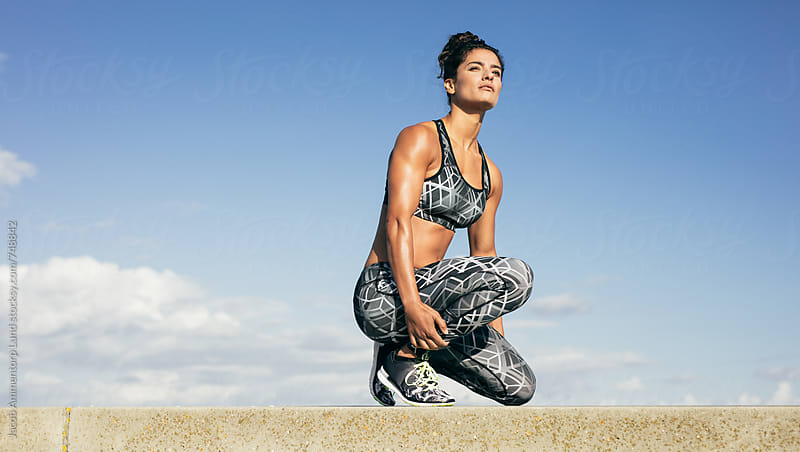 Woman Taking a Break From Outdoor Workout by Jacob Lund for Stocksy United