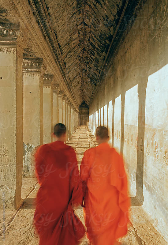 Monks walking inside Angkor Wat, UNESCO World Heritage Site, Siem Reap, Cambodia, Indochina, Southeast Asia, Asia by Gavin Hellier for Stocksy United