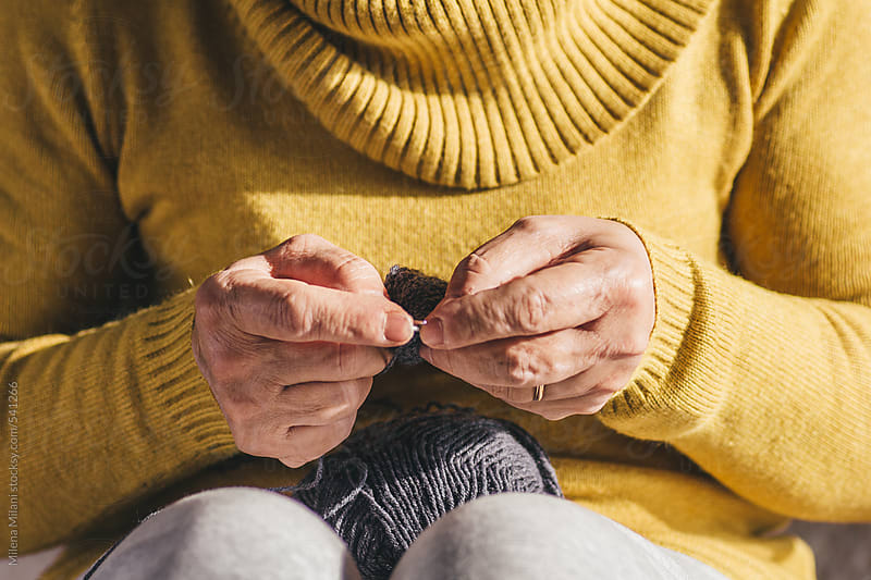 Woman knitting by Milena Milani for Stocksy United