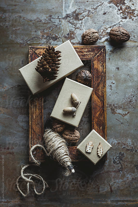Wooden frame with gifts by Tatjana Ristanic for Stocksy United