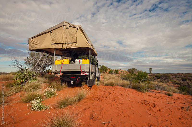 four wheel driver with rooftop camper in Outback Australia by Gillian Vann for Stocksy United