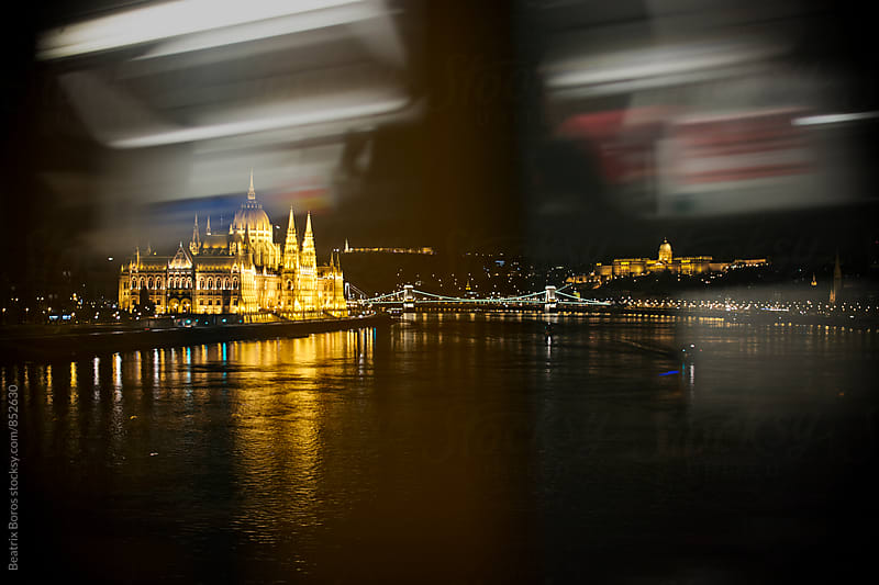 Tram's motion blur in front of the view of Budapest by Beatrix Boros for Stocksy United