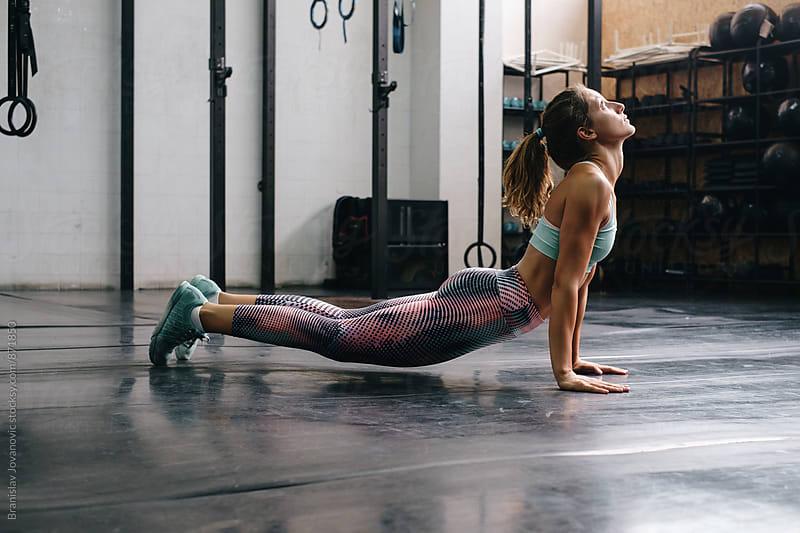 Woman Stretching at the Gym by Branislav Jovanović for Stocksy United