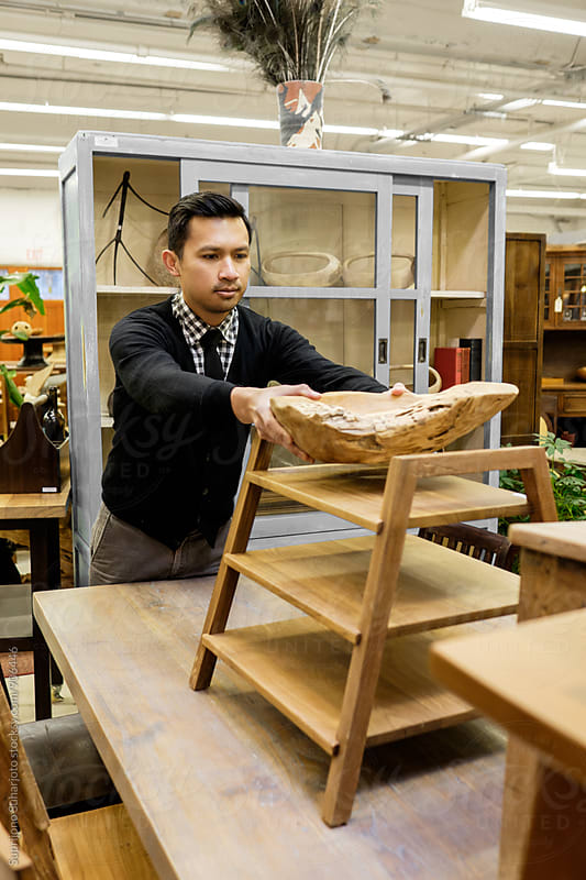 Small business owner working at his furniture store by Suprijono Suharjoto for Stocksy United