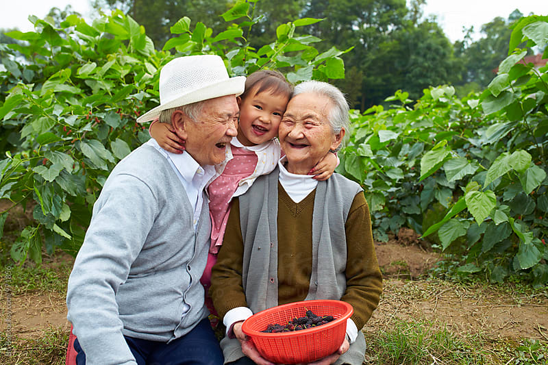 happy little girl with her great grandparents by Bo Bo for Stocksy United