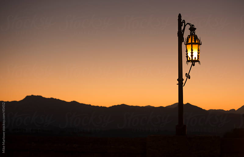 Old fashioned style street lamp against sunset background. by Mike Marlowe for Stocksy United
