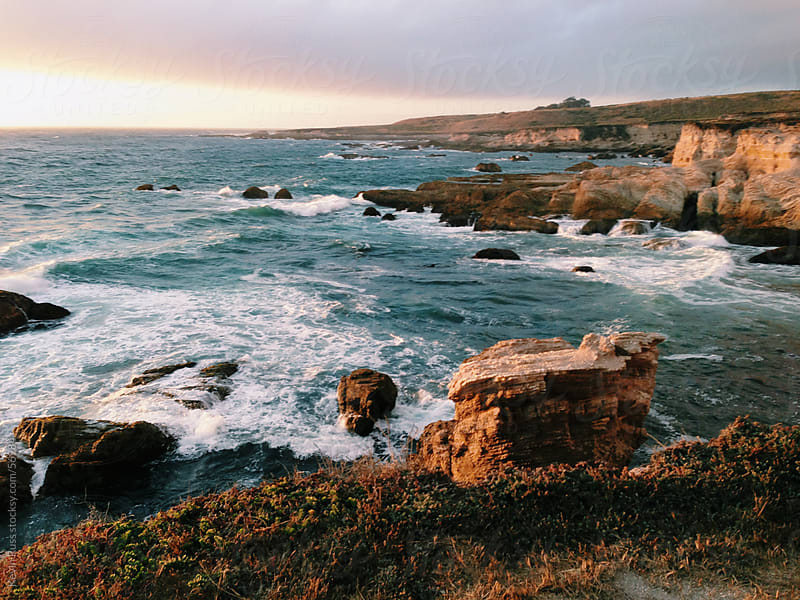 Dramatic Coastline at Sunset by Kevin Russ for Stocksy United