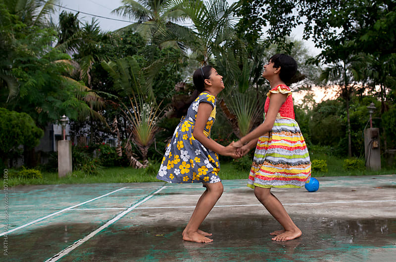 Teenage Girls Playing and making fun by PARTHA PAL for Stocksy United