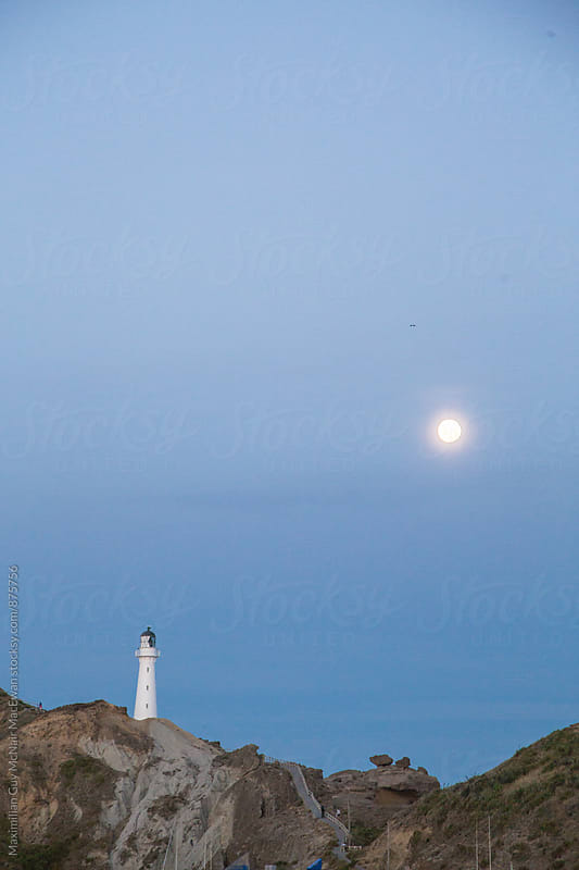 Castle Point Lighthouse and moonrise by Maximilian Guy McNair MacEwan for Stocksy United