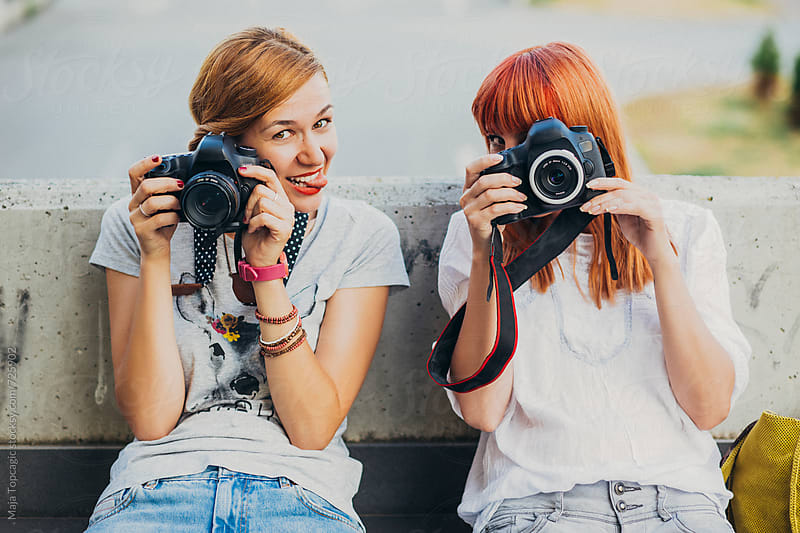 Two photographers having fun by Maja Topcagic for Stocksy United