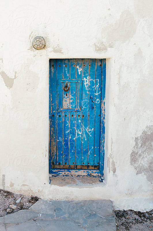 blue door on white windmill of Mykonos, Greece in the Cyclades by Tara Romasanta for Stocksy United