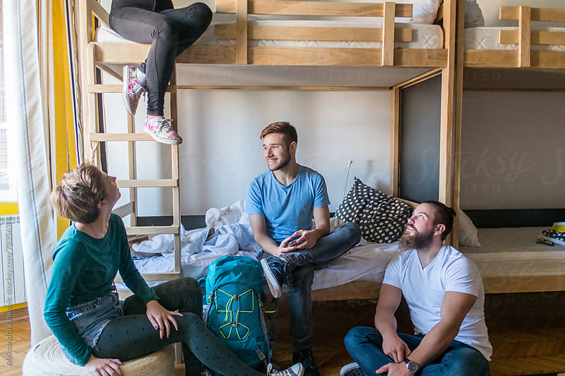 Group of Young People Sitting on the Bunk Bed at the Hostel by Aleksandra Jankovic for Stocksy United