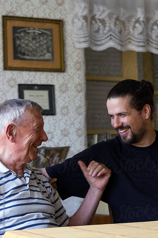 Grandpa and his adult grandson having a laugh by Jovana Milanko for Stocksy United