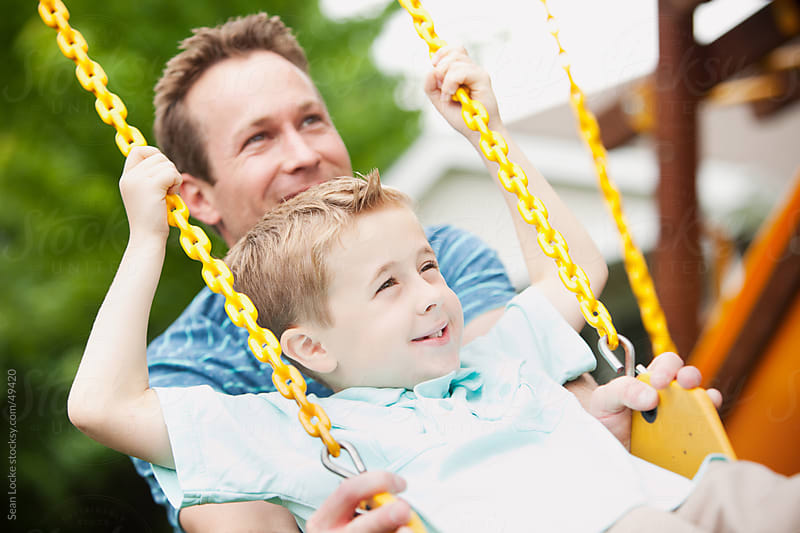 Father: Pushing Son on Swing by Sean Locke for Stocksy United