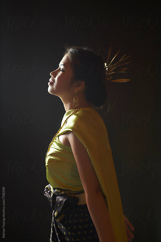 Woman In A Traditional Thai Dress by Adrian Young for Stocksy United