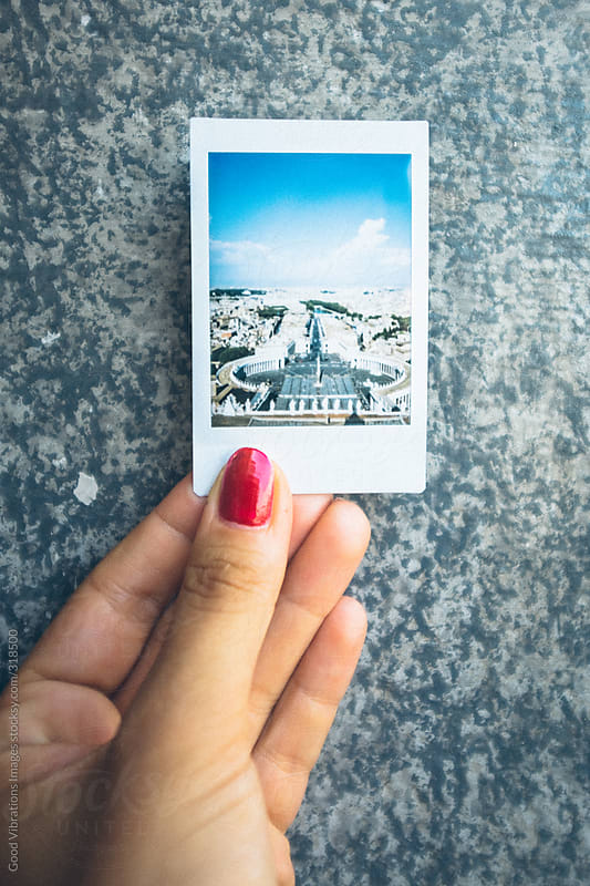 Hand holding polaroid from Rome by Good Vibrations Images for Stocksy United