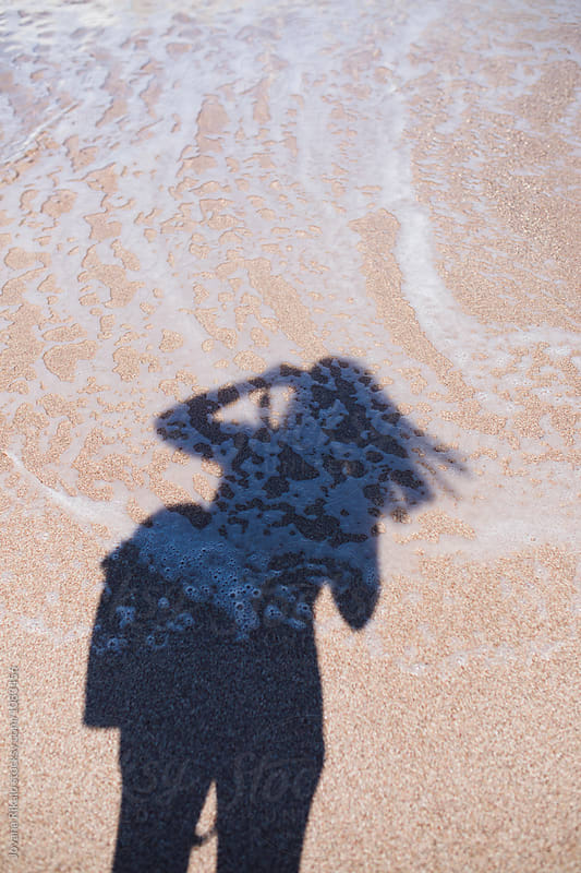 Photographer shadow in a water by Jovana Rikalo for Stocksy United