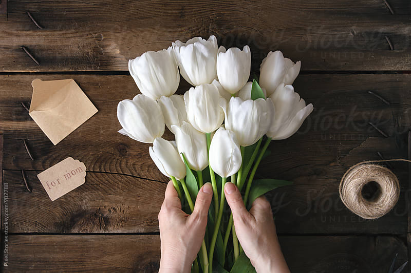 Making white tulips bouquet for Mother's Day  by Pixel Stories for Stocksy United
