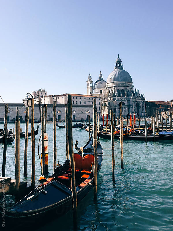 View of Santa Maria della Salute with gondolas by Kirstin Mckee for Stocksy United