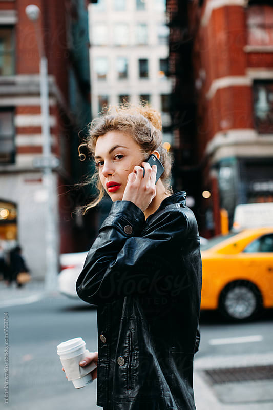 Business woman on the phone walking down the street by michela ravasio for Stocksy United