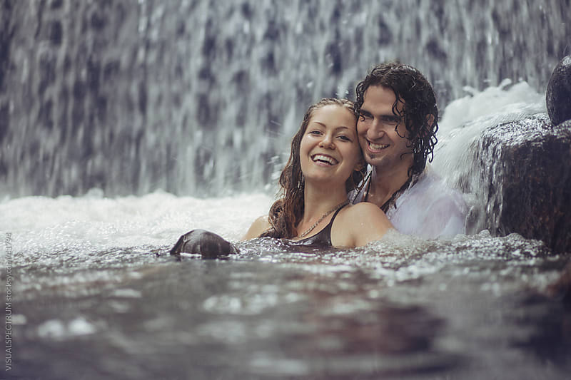 Young Couple Having Fun in a Pool by Julien L. Balmer for Stocksy United