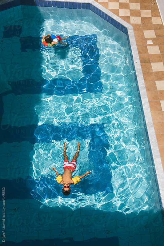 Children in to the pool by Dejan Ristovski for Stocksy United