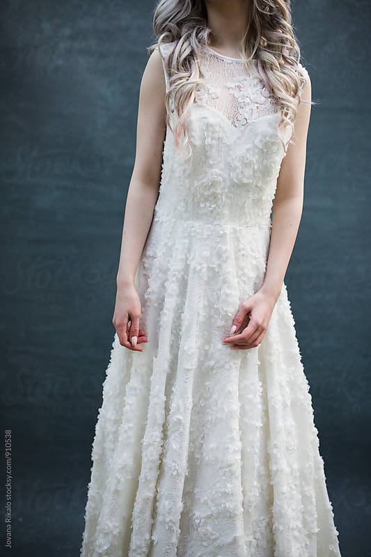 Young woman wearing white long dress by Jovana Rikalo for Stocksy United