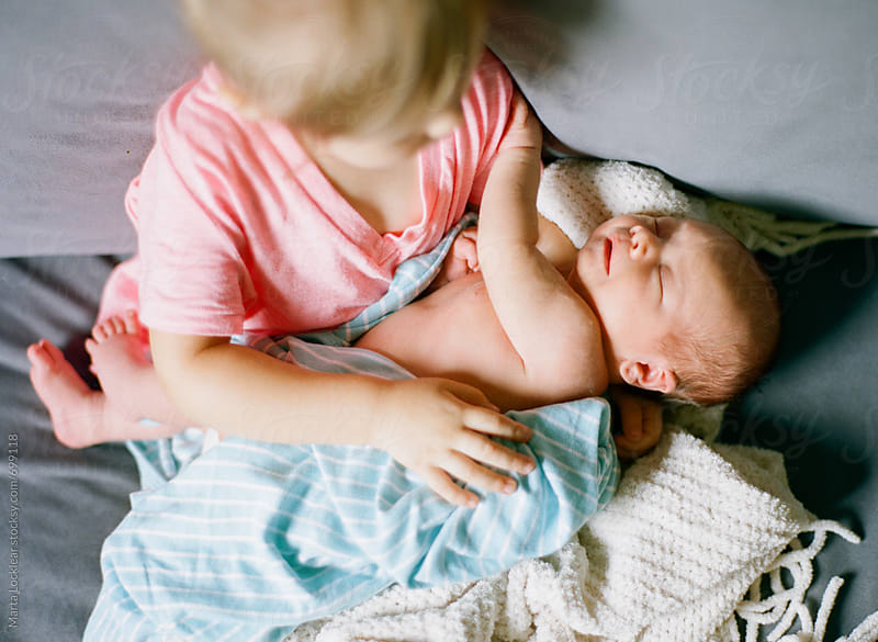 Aerial view of a little girl holding her baby brother by Marta Locklear for Stocksy United
