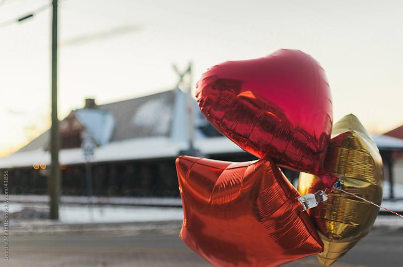 Three shiny mylar baloons by Deirdre Malfatto for Stocksy United