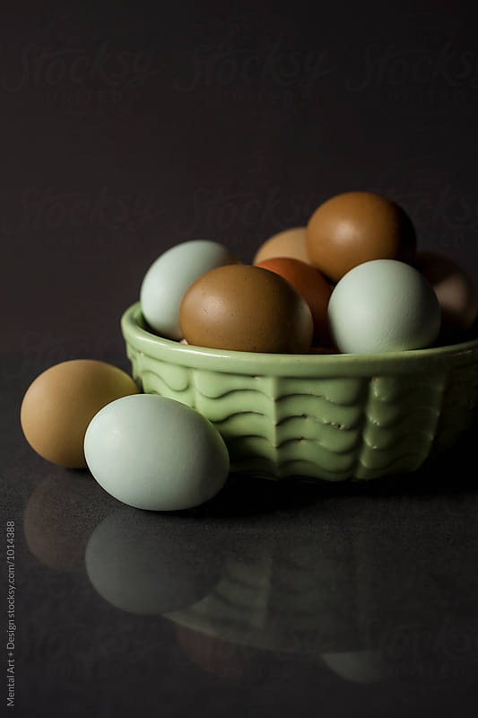 Eggs in a bowl by Mental Art + Design for Stocksy United