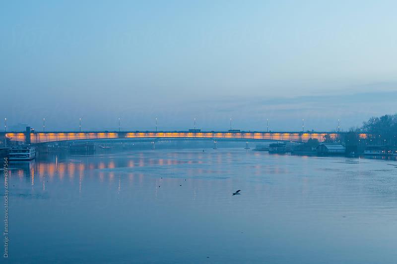 Winter sunset above the Sava river in Belgrade, Serbia by Dimitrije Tanaskovic for Stocksy United