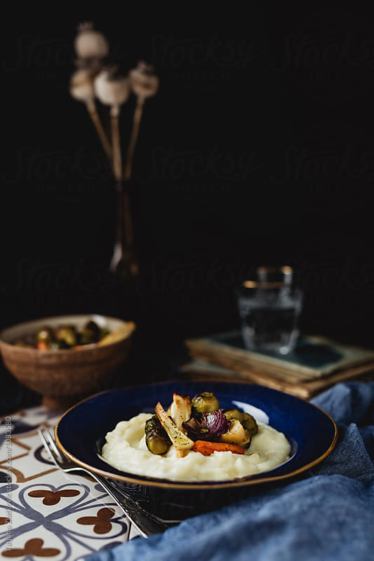 Mashed potatoes with roasted vegetables by Tatjana Ristanic for Stocksy United