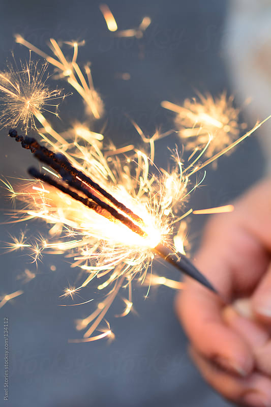 Sparklers shower. by Pixel Stories for Stocksy United
