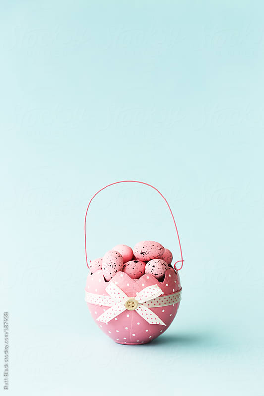 Easter basket filled with Easter eggs by Ruth Black for Stocksy United
