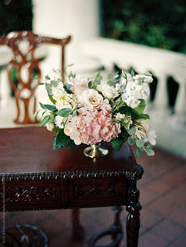 wedding flowers on antique table by Kirill Bordon photography for Stocksy United