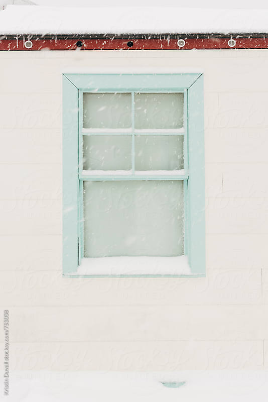 Window during snowstorm by Kristin Duvall for Stocksy United
