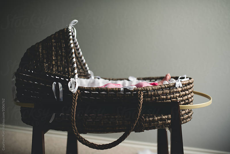 Moses basket with baby inside by Courtney Rust for Stocksy United