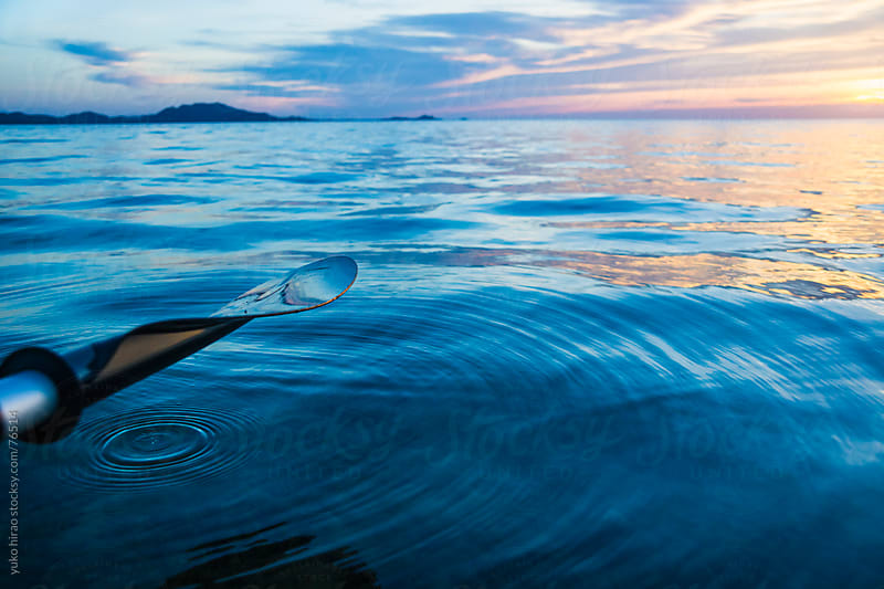 Ripple in the ocean at Sunset kayaking by yuko hirao for Stocksy United