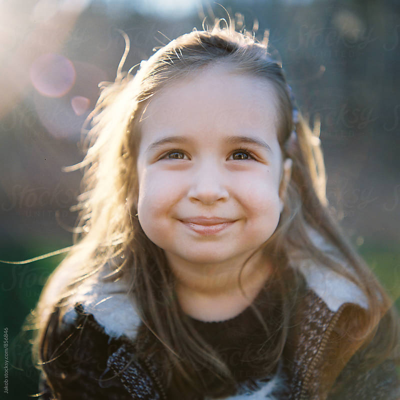 Close up portrait of a beautiful young girl with big cheeks by Jakob for Stocksy United