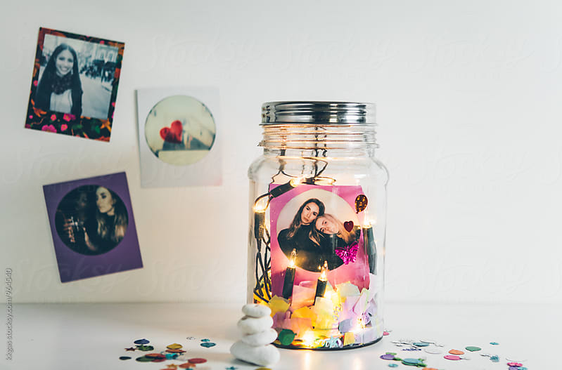 Friendship jar,  best friend polaroid photo with twinkle lights and glitter by kkgas for Stocksy United