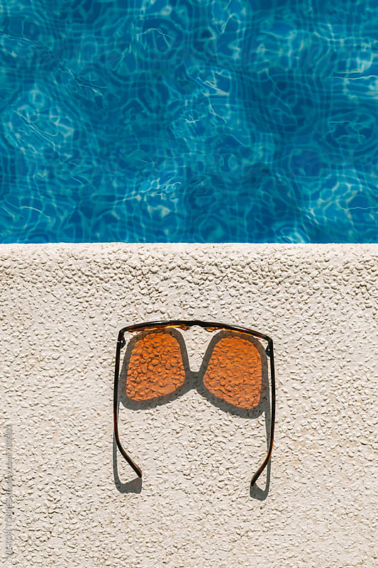 Brown Sunglasses at the Pool by Victor Torres for Stocksy United