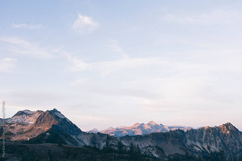 View of the Wenatchee and Chiwaukum Mountains at dusk by Paul Edmondson for Stocksy United