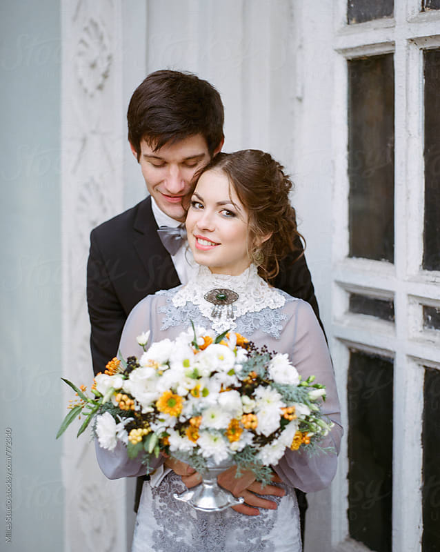 Tender couple at their wedding by Milles Studio for Stocksy United