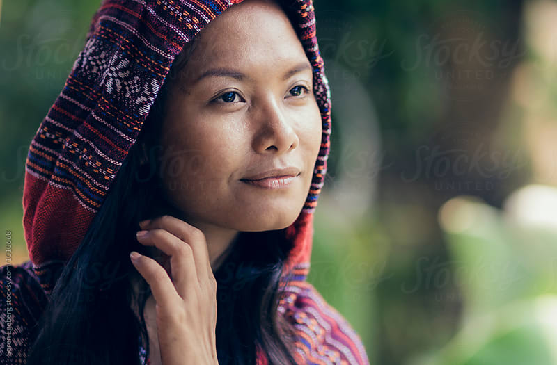 Portrait of young asian woman in traditional clothing by Søren Egeberg Photography for Stocksy United