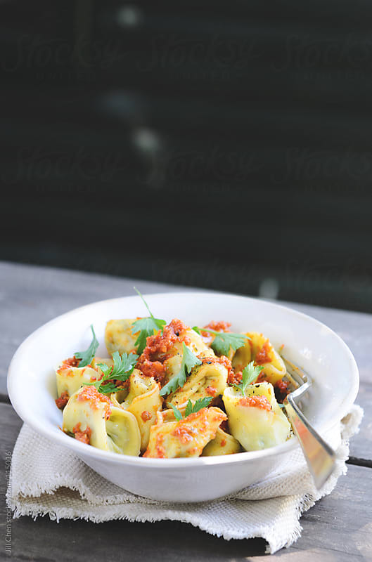 Pasta meal of delicious ravioli in a bowl by Jill Chen for Stocksy United